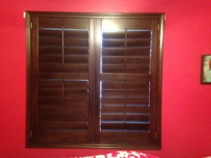 stained wood shutters